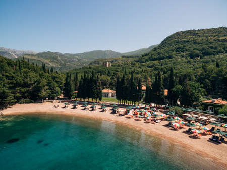 View of the royal beach of Przno in Montenegro against the backdrop of green slopes Imagens