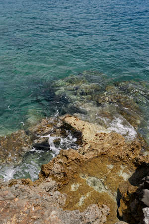 Large stone ledges rising from the sea water