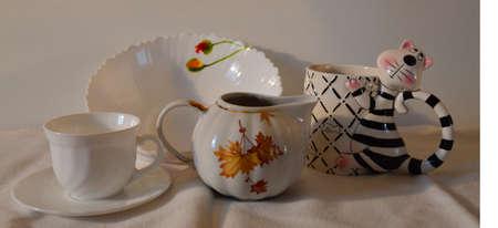 tableware life: The still life. Tableware. Mug, saucer, mug-tiger dish, milk jug.