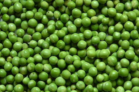Green peas close up. Background. Archivio Fotografico