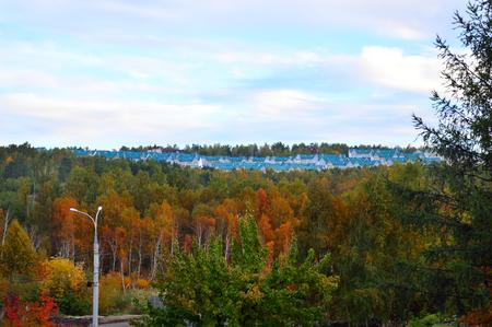 Autumn urban landscape. Cottage village on the hill in the woods. Russia, Irkutsk.