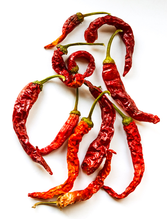 Red hot peppers on white background. In the form of a monogram. Background.