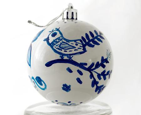 Handmade Christmas ball. Blue bird on a white background. Fabulous bird. 스톡 콘텐츠