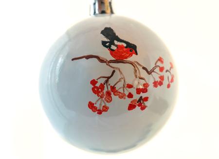 Christmas ball handmade. Bird bullfinch sitting on a branch of mountain ash 스톡 콘텐츠