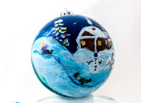 Christmas ball handmade. Winter fun. Christmas tree and slide. Snowman stands under the mountain. The house is on top. 스톡 콘텐츠