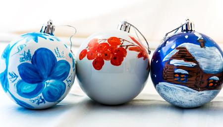 Three handmade Christmas balls on white background. Beautiful design.