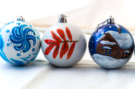 Three handmade Christmas balls on white background. A wonderful gift for the holiday.