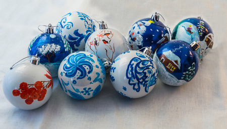 Christmas balls handmade on white background. Beautiful design and a wonderful gift for the holiday. Many wonderful toys.