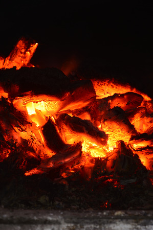 Burning coals in the oven. Orange Heat. From the fire comes a very strong heat. Vrertical photography.