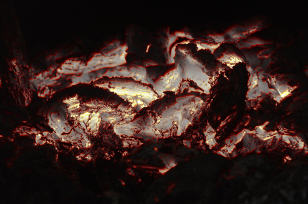 Abstract fire texture. Burning coals. In brown shades.