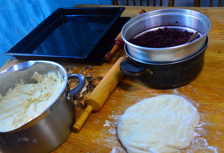 The items on the table for making a cranberry pie.
