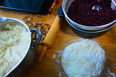 The items on the table for making a cranberry pie. Birthday cake.
