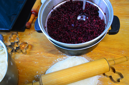 Preparation of lingonberry pie. The ingredients are laid out on the table.