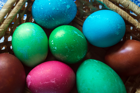 Easter painted eggs. Multicolored. Lots of chicken eggs and one goose egg. Preparation for the holiday. 스톡 콘텐츠