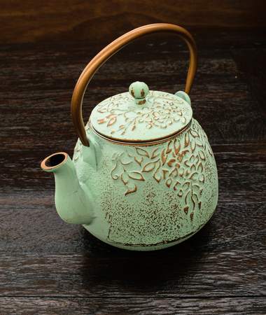goldish: pale green caste iron brewing teapot with copper handle
