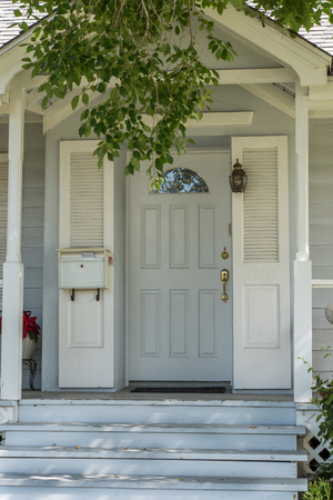 lite: house entrance door with half moon lite and side panels Stock Photo