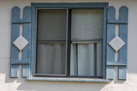 faux: simple slide window with pale blue  faux shutters