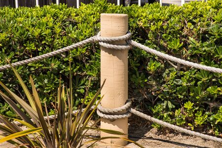 post of rope fence with knots horizontal background 版權商用圖片