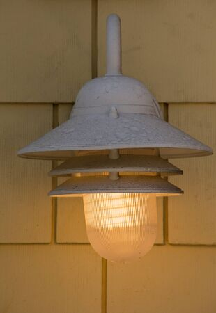 fixture: street light fixture mounted on a wall glowing soft yellow light