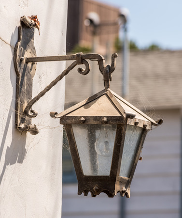 light fixture: old street light fixture mounted on a wall white with decorative details