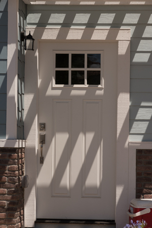 lite: house entrance white wooden door with one third lite