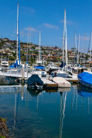 dinghies: yachts moored at marina at beautiful sunny day Stock Photo