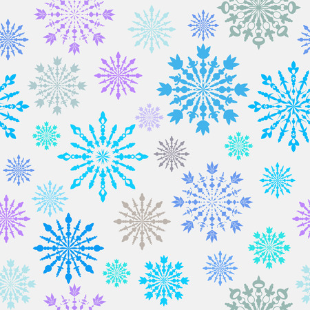 Seamless pattern with large and small blue, grey, lilac carved snowflakes on light background