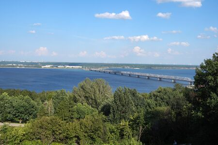 Beautiful summer landscape. River View. The long bridge over the river. Nature. Russia.
