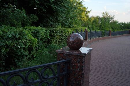 Stone path in the summer park. Green city park. Russia.