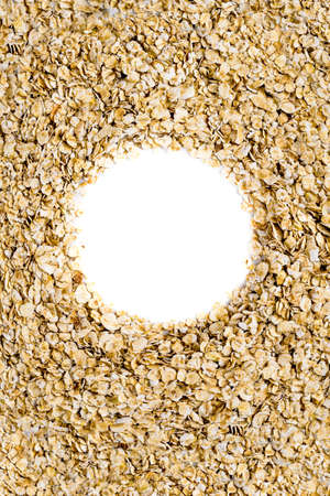 Oatmeal, oatmeal texture. Top view in the form of a circle. Space for text, Copyspace.