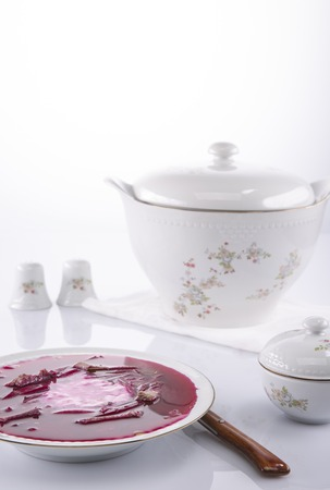 tureen: Russian borscht in a white plate and a tureen Stock Photo
