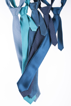Five silk ties turquoise color on a white background Stock Photo