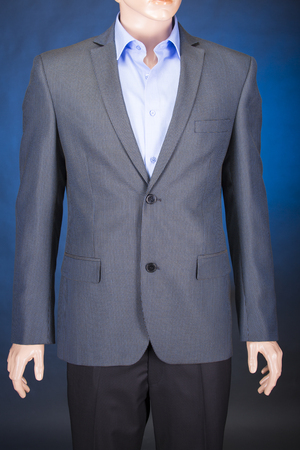 tailored: Jacket in a cage, blue shirt, black pants on a mannequin