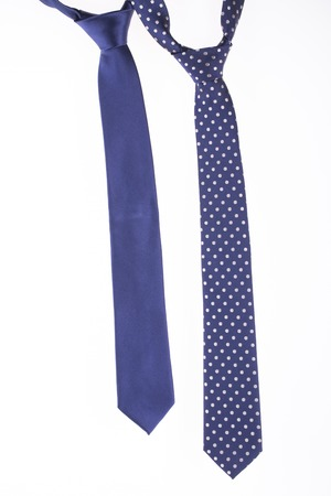 Two blue tie on a white background