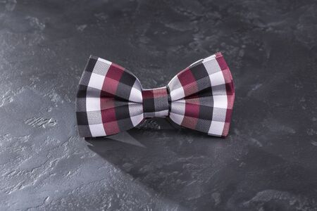spot the difference: Bow tie on a beautiful dark gray background.