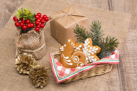 Two gingerbread with Christmas pattern, viburnum in a vase of scrim.