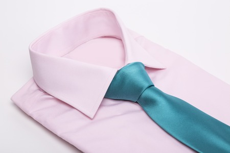 Pink shirt and tie on white background