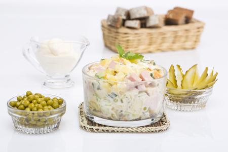 ensaladilla rusa: Russian traditional salad Olivier, isolated on white Foto de archivo