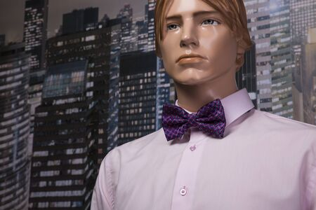 Pink shirt and bow tie placed on a mannequin Stock Photo