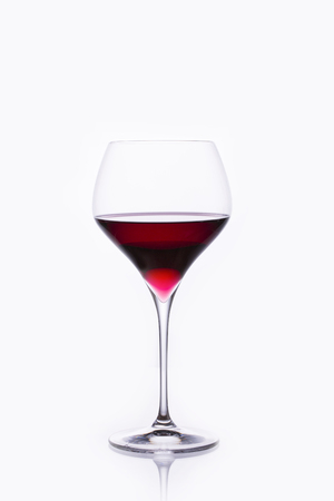 Beautiful inside a large glass of red wine on a white background