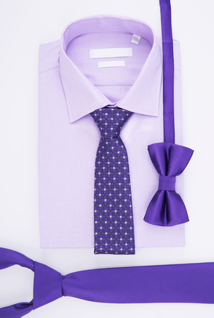 windsor: Purple shirt and tie tied Windsor knot. On a white background, Stock Photo