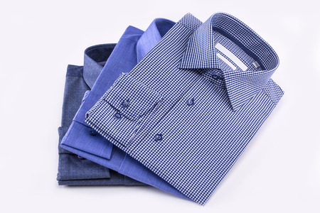 Mens shirts set. Folded on a white background. Stock Photo
