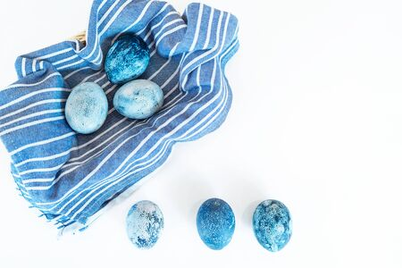 Blue easter eggs in a basket. Coloring eggs for the holiday of Holy Easter with natural paints.