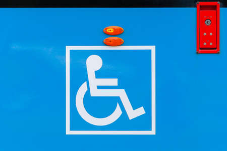sign for disabled at city tram side, public transport accessibility