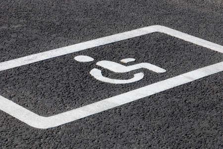 parking spot for disabled drivers, road marking on asphalt road