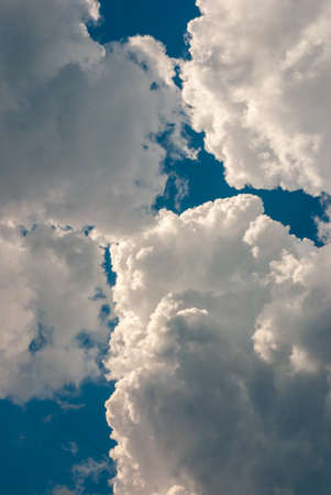 beautiful thunderous clouds in blue sky before thunderstorm, vertical pic