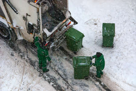 household waste collection in winter snowy weather