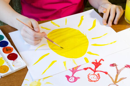 the child draws the sun photo