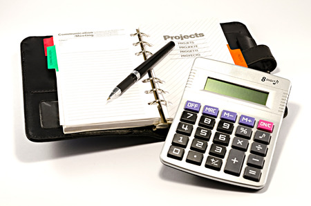note pad with pen and calculator photo
