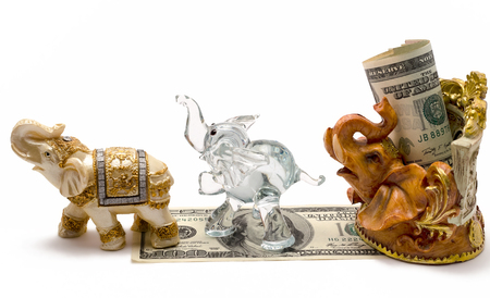 money with a figurine of an elephant photo